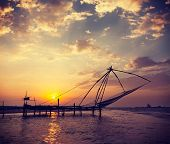 picture of fishnet  - Vintage retro hipster style travel image of Kochi chinese fishnets on sunset - JPG