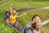 pic of luge  - Excited young couples enjoying alpine coaster luge during summer - JPG