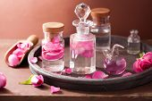 foto of flask  - alchemy and aromatherapy set with rose flowers and flasks - JPG