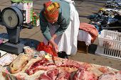 UKRAINE, KIEV - MARCH 31, 2007:  Meat seller in open air market.  Open air markets are still popular