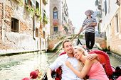 picture of gondola  - Romantic travel couple in Venice on Gondole ride romance in boat happy together on travel vacation holidays - JPG