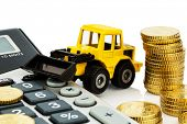 cost accounting in the construction industry and the construction industry. higher higher prices in road construction and in residential construction. excavator with coins and calculator