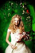 stock photo of loach  - Lovely girl in a lush white dress stands under a floral arch over green background - JPG