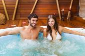 Smiling couple relaxing in a whirlpool