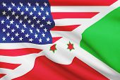 stock photo of burundi  - Flags of USA and Burundi blowing in the wind - JPG