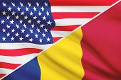 stock photo of chad  - Flags of USA and Chad blowing in the wind - JPG
