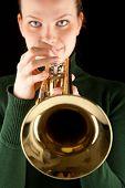 Beautiful Blonde Girl Holds A Golden Trumpet
