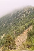 picture of landslide  - A landslide in the Rocky Mountains while being covered by fog - JPG