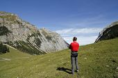 Man Is Standing Alone In The Austrian Mountains