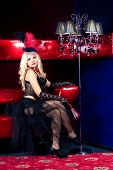 image of moulin rouge  - Girl in the clothes of past years in style Cabaret Moulin Rouge - JPG