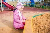 sad girl on the playground