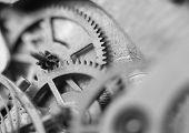 Black White Background With Metal Cogwheels A Clockwork. Conceptual Photo