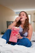 Woman In Bed With Popcorn