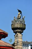pic of king cobra  - King Yoganarendra Malla bronze statue under a cobra snake over stone column - JPG