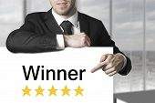 Businessman Pointing On Sign Winner Golden Stars
