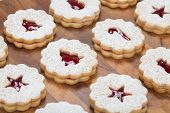 picture of linzer  - Traditional Austrian Linzer Christmas cookies aranged on a wooden background