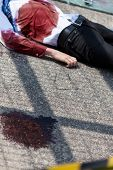 stock photo of blood drive  - Dead man after car accident on the street - JPG