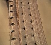 picture of eyeleteer  - eyelets and hooks used in girdles and in corsets - JPG
