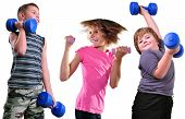 Isolated Portrait Of Children Exercising With Dumbbells