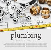 foto of plumbing  - plumbing and tools on a gray background - JPG