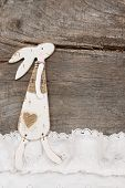 Easter decoration with a rabbit on a brown wooden background