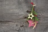 Top view of christmas decoration with antler and checked star on a wooden background