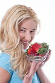 picture of strawberry blonde  - Caucasian blond smiling woman holding a bowl of strawberry - JPG
