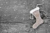 Santa or christmas boot on a wooden shabby chic background for a greeting card