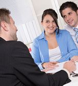 image of rep  - Happy couple discussing future financial plans with consultant - JPG