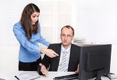 Misunderstanding under men and woman - businessman have a discussion with a female colleague