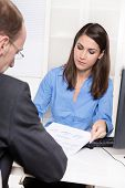 Consulting or business meeting - young businesswoman sales an insurance - customer service at a bank