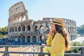 Portrait Of Thoughtful Young Woman In Front Of Colosseum In Rome, Italy