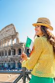 Happy Young Woman With Italian Flag In Front Of Colosseum In Rom