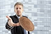 pic of throw up  - Close up of businessman throws a coin - JPG