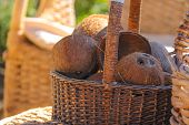 Wicker Furniture And Basket With Coconut On The Beach