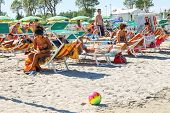 Tourists Sunbathe On  Beach In The Resort Town Bellaria Igea Marina, Rimini, Italy