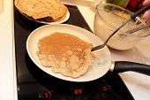 image of gold panning  - Flaxseed meal pancake on a brown pan - JPG