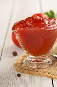 tomato sauce on wooden background