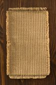 burlap hessian sack on wooden background