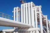 picture of gas-pipes  - Industrial pipe with gas and oil and water on a background of blue sky - JPG