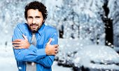 stock photo of tramp  - Portrait of a freezing businessman outdoor - JPG