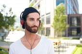 Handsome Young Man Outdoors With Headphones