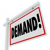 Demand word on a real estate home or house for sale sign for property in the hottest, most popular location in the market