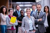 stock photo of leader  - young multi ethnic business people group walking standing and top view - JPG