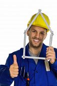 a worker in an industrial enterprise with helmet wants to build a house.