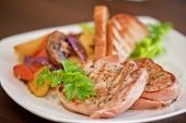 stock photo of pork chop  - Pork chop with vegetable at plate - JPG