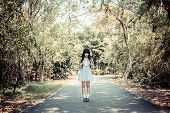 A Cute Asian Thai Girl Is Standing On A Forest Path Alone In Vintage Color Style