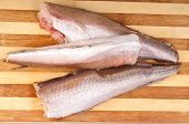 picture of hake  - frozen fish hake on cutting board background - JPG