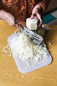 Woman Shredding Cabbage By Manual Slaw Cutter