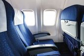 stock photo of section  - blue seats in economy class passenger section of airplane - JPG